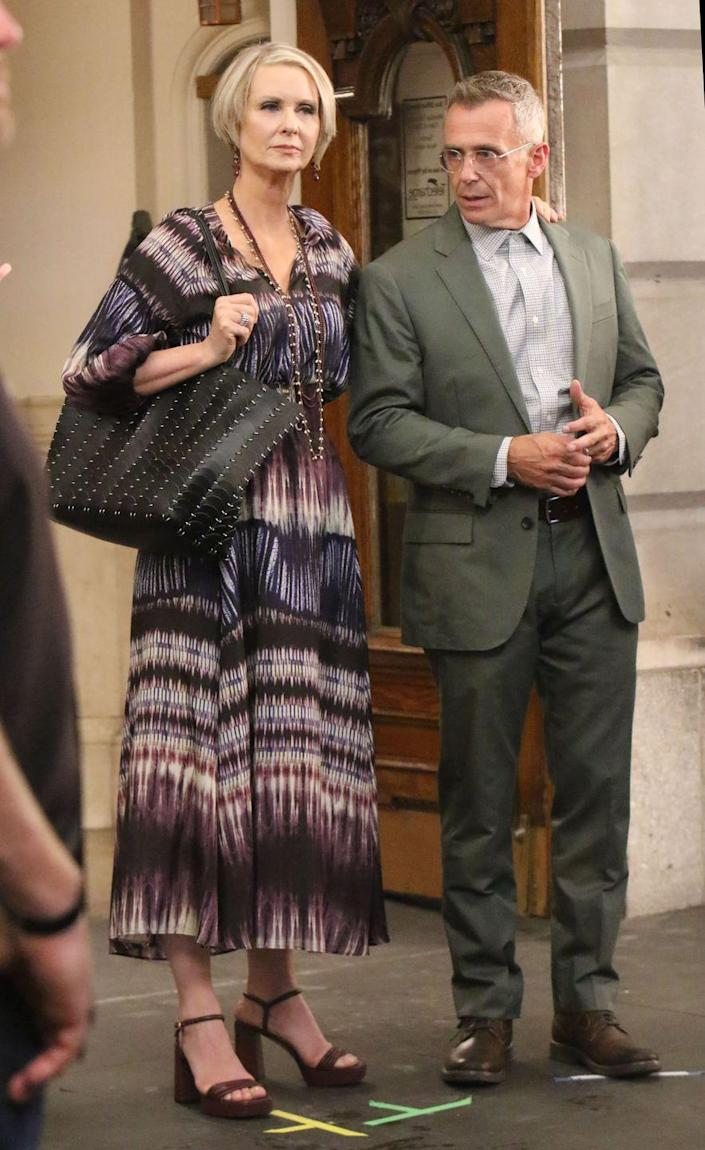 <p>Steve Brady's David Eigenberg was seen on set with Miranda Hobbes's Cynthia Nixon in another Paul Smith Soho single-breasted wool-blend suit, while Nixon wore a Gerard Darel Nahomy silk tie-dye blouse and matching Laisa silk skirt. </p>
