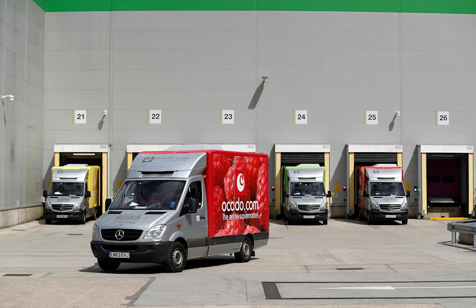 A delivery van leaves the dispatch area of the Ocado CFC (Customer Fulfilment Centre) in Andover, Britain May 1, 2018. Picture taken May 1, 2018.  REUTERS/Peter Nicholls