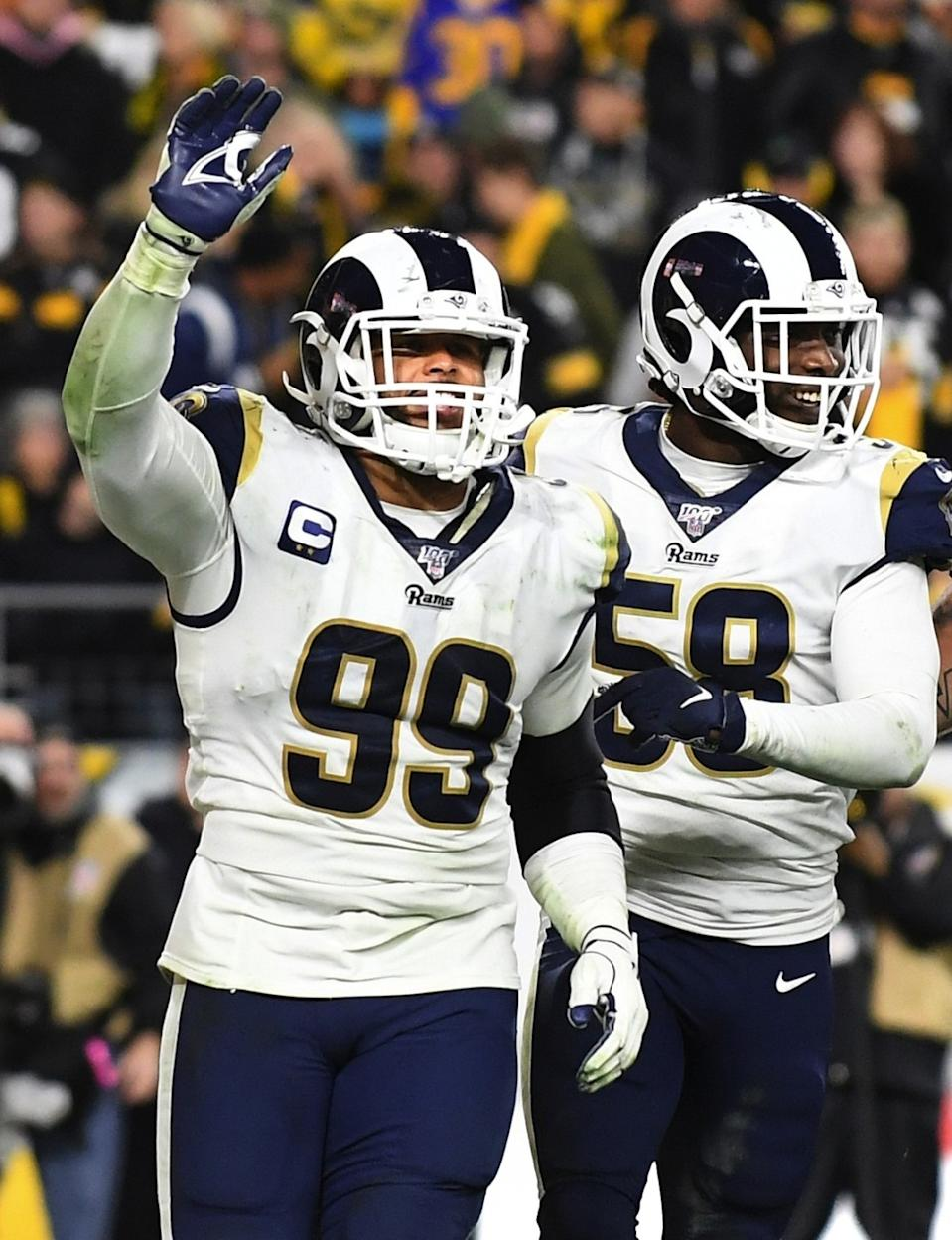 Rams defensive lineman Aaron Donald (99) celebrates a defensive play against the Chicago Bears.