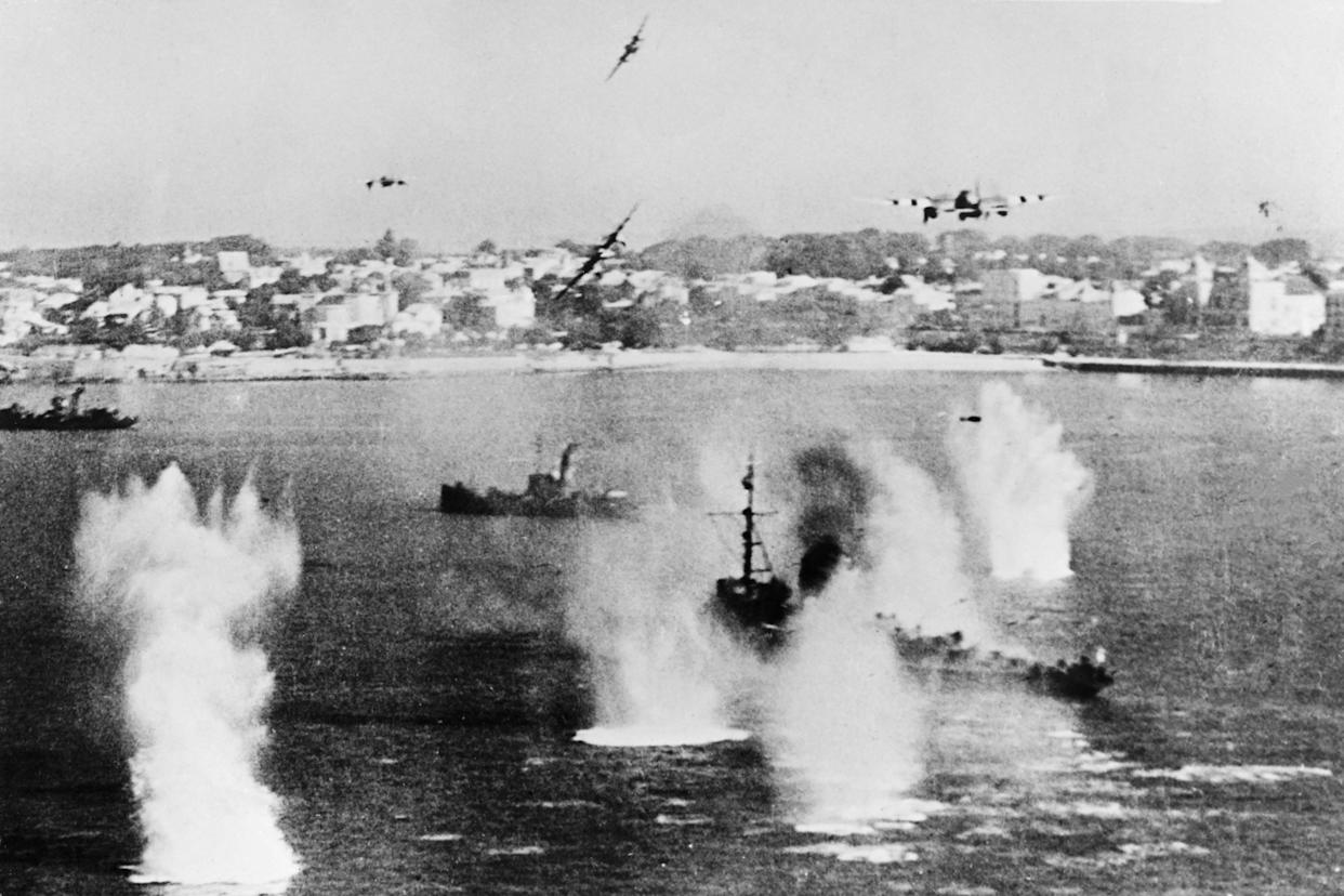 Allied forces' military planes bombing enemy boats in order to prepare the allied troops landing aimed at fighting the German Wehrmacht as part of the Second World War.