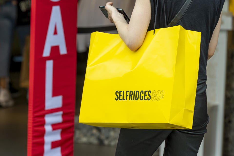 A woman is seen holding a selfridges shopping bag on London�s Oxford Street after the shops were allowed to reopen. (Photo by Dave Rushen / SOPA Images/Sipa USA)