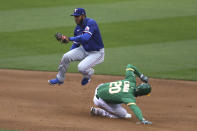 Texas Rangers Elvis Andrus forces out Oakland Athletics Mark Canha on a fielders choice hit by Robbie Grossman during the fifth inning of a baseball game in Oakland, Calif., Tuesday, Aug. 4, 2020. (AP Photo/Jed Jacobsohn)
