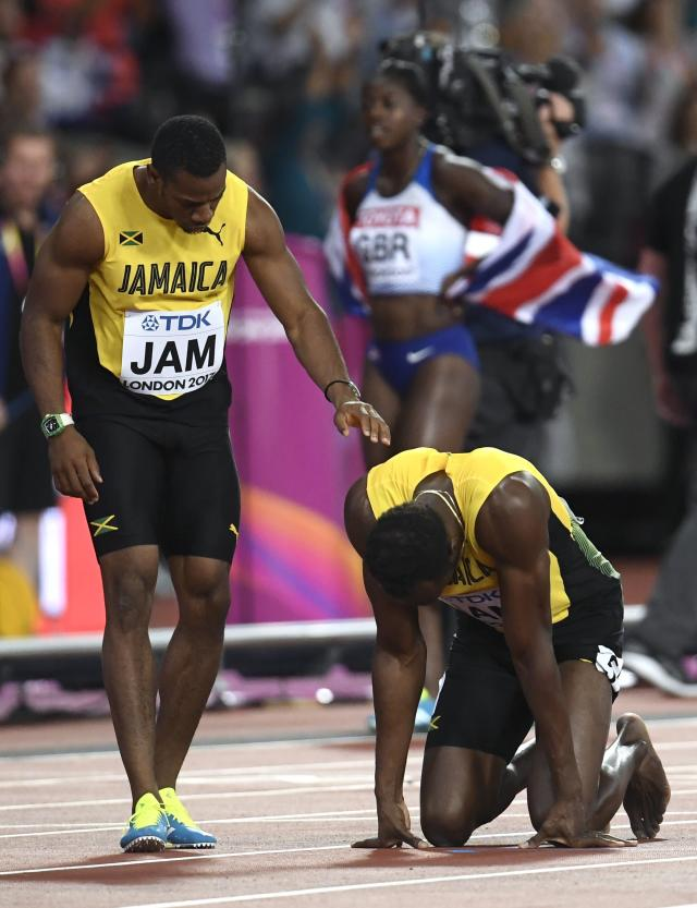 Athletics - World Athletics Championships - Men's 100 Metres Relay Final - London Stadium, London, Britain – August 12, 2017. Yohan Blake and Usain Bolt of Jamaica react after the final. REUTERS/Toby Melville