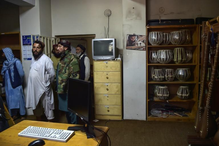 The Taliban have vowed a more moderate brand of rule than their last stint in power -- but still within the limits of sharia law (AFP/WAKIL KOHSAR)