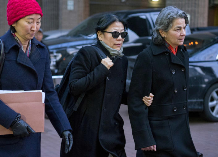 Sheri Yan, CEO of the Global Sustainability Foundation, center, leaves federal court in New York City on Jan. 20, 2016, after she pleaded guilty in connection with a scheme to bribe John Ashe, the former U.N. General Assembly president. (Photo: Craig Ruttle/AP)