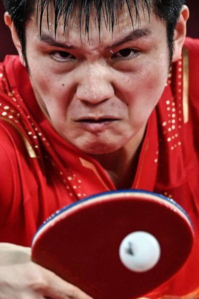 PHOTO: China's Fan Zhendong competes against South Korea's Jang Woo-jin during their men's team semifinal table tennis match at the Tokyo Metropolitan Gymnasium during the Tokyo 2020 Olympic Games in Tokyo on Aug. 4, 2021. (Jung Yeon-je/AFP via Getty Images)