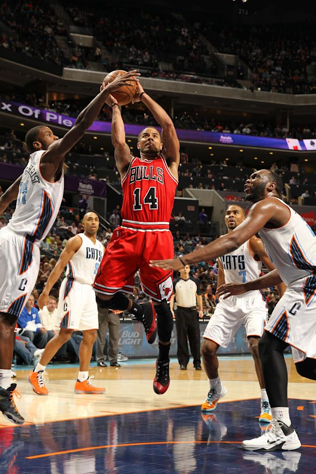 CHARLOTTE, NC - JANUARY 25: D.J. Augustin #14 of the Chicago Bulls shoots against Michael Kidd-Gilchrist #14 and the Charlotte Bobcats during the game at the Time Warner Cable Arena on January 25, 2014 in Charlotte, North Carolina. (Photo by Kent Smith/NBAE via Getty Images)