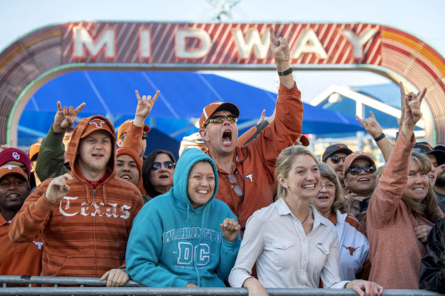 Texas fans cheer before an NCAA college football game between against Oklahoma at the Cotton Bowl, Saturday, Oct. 12, 2019, in Dallas. (AP Photo/Jeffrey McWhorter)