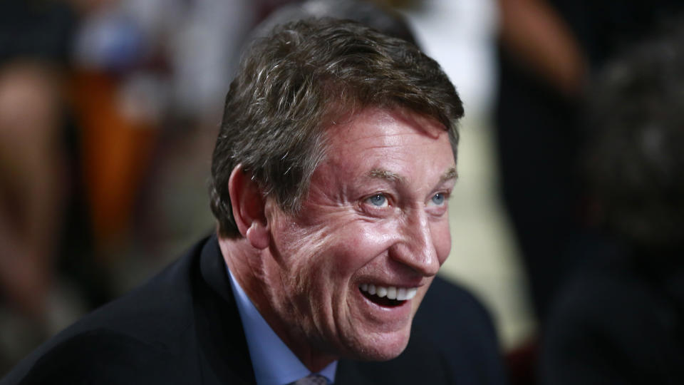 VANCOUVER, BRITISH COLUMBIA - JUNE 21: Former NHL player Wayne Gretzky of the Edmonton Oilers looks on from the draft table during the first round of the 2019 NHL Draft at Rogers Arena on June 21, 2019 in Vancouver, Canada. (Photo by Jeff Vinnick/NHLI via Getty Images)