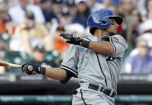 Texas Rangers' Rougned Odor hits a three-run triple against the Detroit Tigers in the seventh inning of a baseball game on Saturday, May 24, 2014, in Detroit. The Tigers and Rangers were celebrating the Negro Leagues by wearing the Detroit Stars and Fort Worth Black Panthers uniforms. (AP Photo/Duane Burleson)