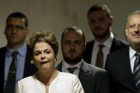Brazil's President Dilma Rousseff arrives for a news conference at the Planalto Palace, in Brasilia, Brazil December 2, 2015. President of the Chamber of Deputies of Brazil Eduardo Cunha, said on Wednesday that he authorized the opening of an impeachment process against Rousseff. REUTERS/Ueslei Marcelino