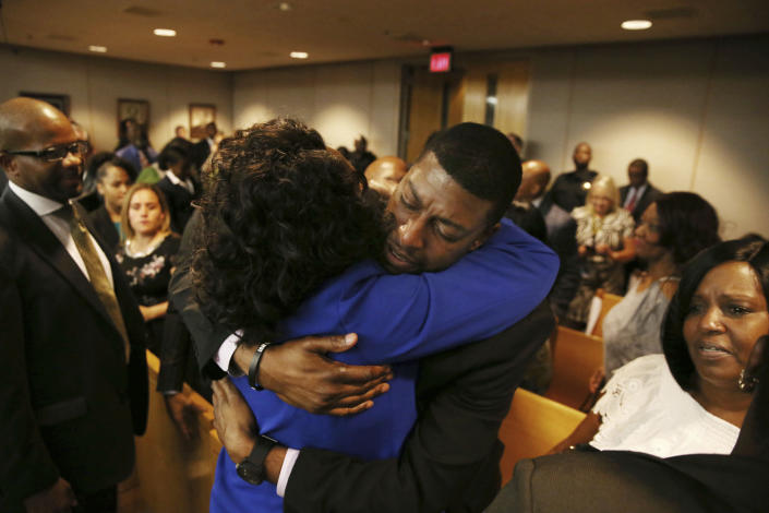 Odell Edwards, father of Jordan Edwards, gets a hug from Dallas County district attorney Faith Johnson after hearing a guilty of murder verdict during the ninth day of the trial of fired Balch Springs police officer Roy Oliver, who was charged with the murder of 15-year-old Jordan Edwards, at the Frank Crowley Courts Building in Dallas on Tuesday, Aug. 28, 2018. (Rose Baca/The Dallas Morning News via AP, Pool)