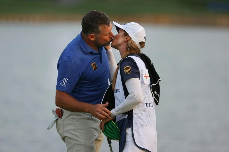 Happy days: Lee Westwood kisses his caddie, fiancee and 'secret weapon' Helen Storey after finishing second at The Players Championship