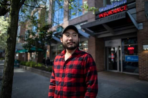 After testing positive for the coronavirus, Hobson Lin wanted to know if he'd caught a more transmissible variant because he had been serving customers at a Starbucks on the morning his symptoms began. But Vancouver Coastal Health says it doesn't give that information to patients. (Ben Nelms/CBC - image credit)