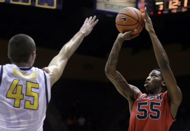 Utah's Delon Wright (55) shoots over California's David Kravish (45) during the first half of an NCAA college basketball game Wednesday, March 5, 2014, in Berkeley, Calif. (AP Photo/Ben Margot)