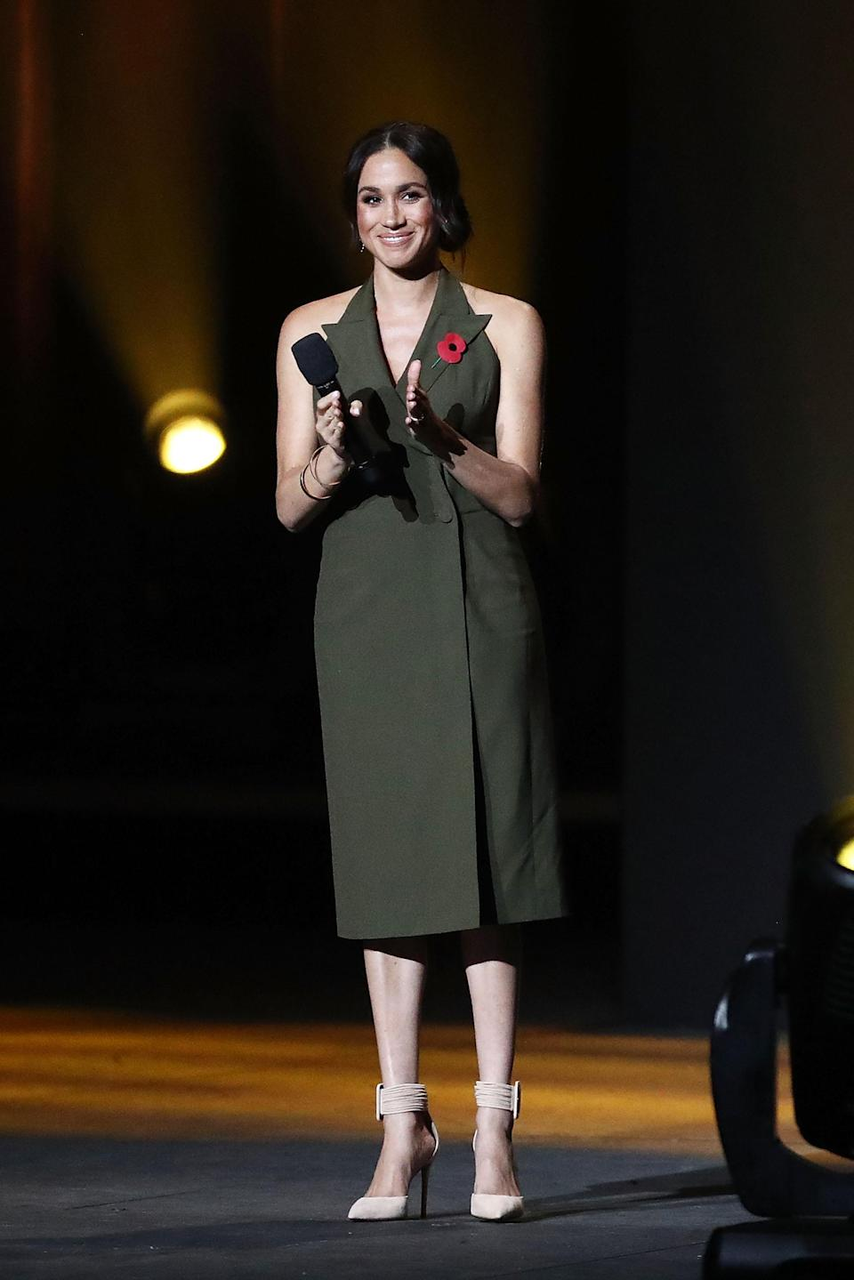 <p>On October 27, Meghan delivered a speech at the 2018 Invictus Games closing ceremony in a green Antonio Berardi tuxedo dress. <em>[Photo: Getty]</em> </p>