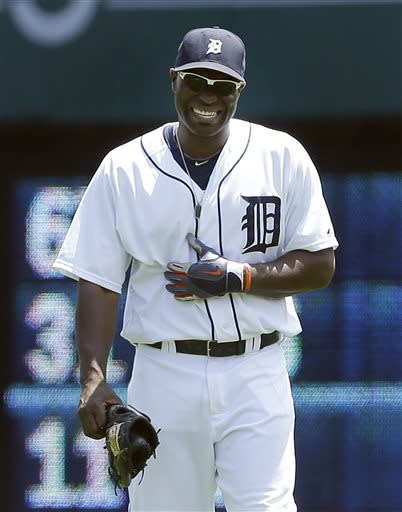 Detroit Tigers right fielder Torii Hunter reacts while holding his stomach after diving for a ball against the Los Angeles Angels in the third inning of a baseball game in Detroit, Thursday, June 27, 2013. The (AP Photo/Paul Sancya)