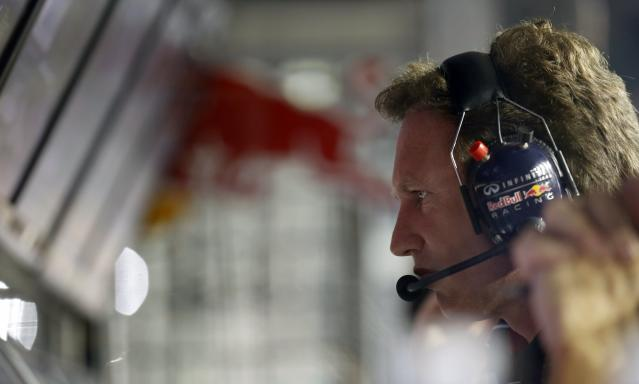 Red Bull Formula One team principal Christian Horner looks at a screen on the pit wall during the qualifying session of the Singapore Formula One Grand Prix September 21, 2013. REUTERS/Pablo Sanchez (SINGAPORE - Tags: SPORT MOTORSPORT F1)
