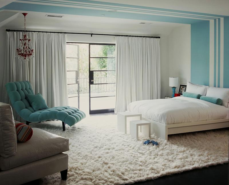 This publicity photo provided by Burnham Design shows a bedroom designed by Betsy Burnham, with walls of pure white and frosty blue  complemented by a fluffy snow-white flokati rug.  (AP Photo/Burnham Design, Grey Crawford)