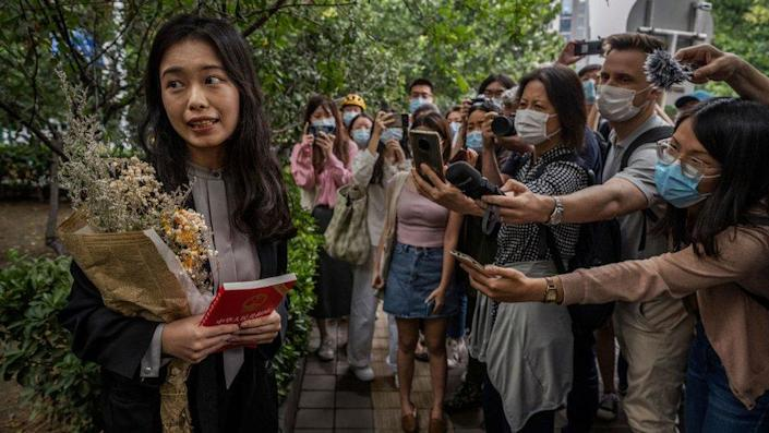 Leading figure in China's #MeToo movement Zhou Xiaoxuan, known also as Xianzi, left, speaks to journalists and supporters outside the Haidian District People's Court before a hearing in her case against prominent television host Zhu Jun on September 14, 2021 in Beijing, China.