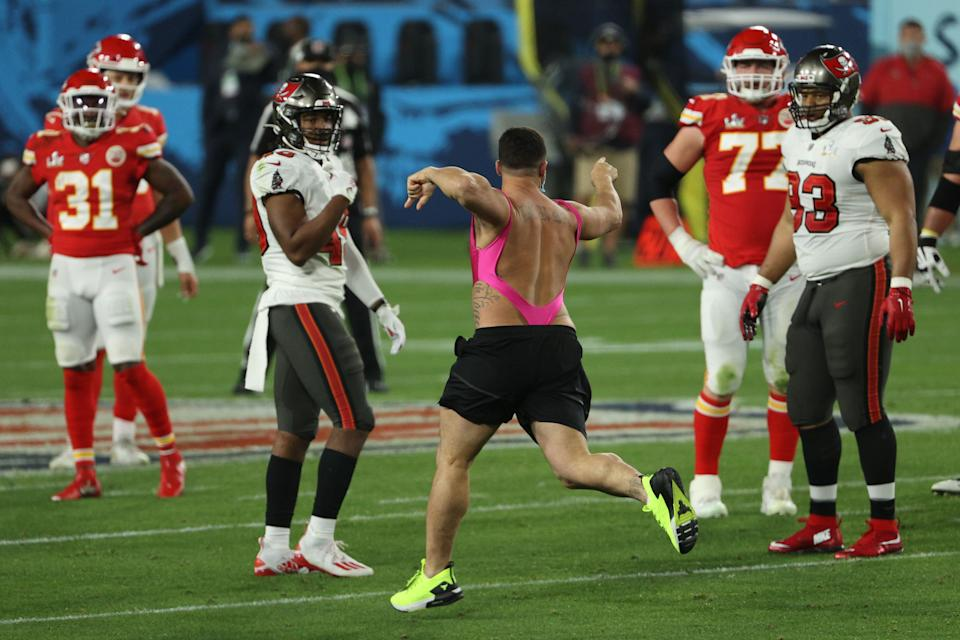 An unidentified man takes the field during the fourth quarter in the 2021 Super Bowl between the Tampa Bay Buccaneers and the Kansas City Chiefs at Raymond James Stadium on Feb. 7, 2021, in Tampa, Florida. (Photo: Patrick Smith via Getty Images)