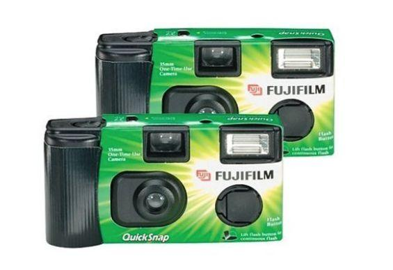 """Make any occasion more fun &mdash; and freak out chidlren &mdash; with an """"old-fashioned"""" 27-exposure disposable camera. Get it <a href=""""https://www.walmart.com/ip/Fujifilm-QuickSnap-Flash-400-Disposable-35mm-Camera-27-exposures/377733626"""" target=""""_blank"""" rel=""""noopener noreferrer"""">at Walmart</a> for $18.99."""