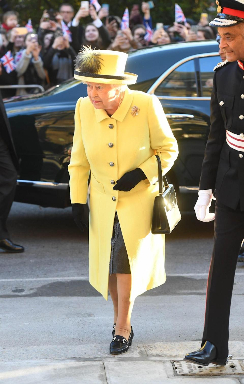 <p>Despite it being the middle of winter, Queen Elizabeth opted for a sunny yellow outfit for a charity visit.<br><i>[Photo: PA]</i> </p>