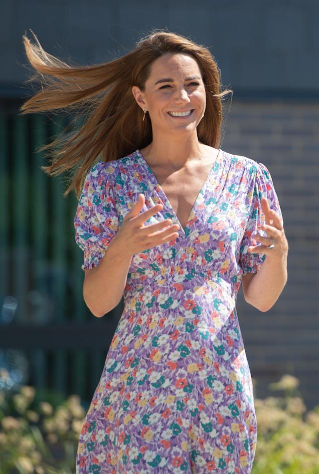 The duchess wore her hair down and straight, a departure from her usual curls. (PA Images)
