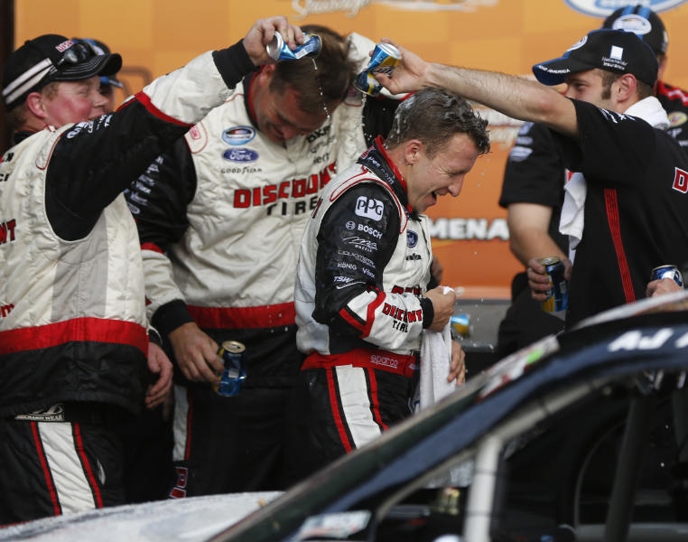 AJ Allmendinger gets beer poured on him after winning the NASCAR Nationwide series Johnsonville Sausage 200 auto race at Road America, Saturday, June, 22, 2013, in Elkhart Lake, Wis. (AP Photo/Mike Roemer)