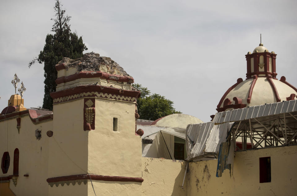 <p>A Catholic church's bell tower is missing after the 7.1-magnitude earthquake in San Gregorio Atlapulco, Mexico, Friday, Sept. 22, 2017. Mexican officials are promising to keep up the search for survivors as rescue operations stretch into a fourth day following Tuesday's major earthquake that devastated Mexico City and nearby states. (AP Photo/Eduardo Verdugo) </p>