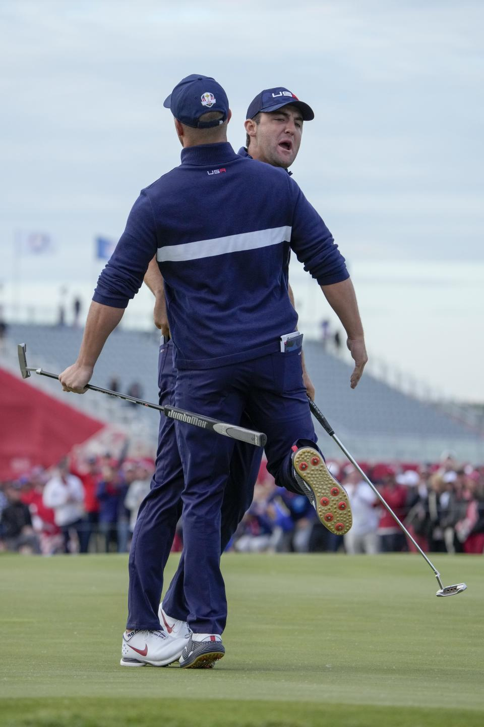 Team USA's Scottie Scheffler celebrates with Team USA's Bryson DeChambeau to making his putt and winning the 15th hole during a four-ball match the Ryder Cup at the Whistling Straits Golf Course Saturday, Sept. 25, 2021, in Sheboygan, Wis. (AP Photo/Ashley Landis)