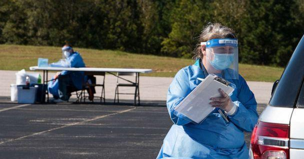 PHOTO: Kathy Hall takes information as Southeast Alabama Area Health Education Center does free rural drive through COVID-19 testing at Good Hope Baptist Church near Eclectic, Ala., Nov. 2, 2020. (Advertiser/Imagn/USA TODAY Network)