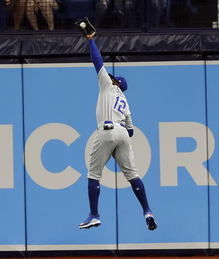 Kansas City Royals right fielder Jorge Soler makes a leaping catch of a fly-out by Tampa Bay Rays' Joey Wendle during the first inning of a baseball game Monday, April 22, 2019, in St. Petersburg, Fla. (AP Photo/Chris O'Meara)
