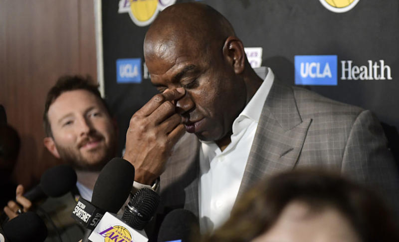 Magic Johnson wipes his eyes as he announces his decision to step down as the LA Lakers' President of Basketball Operations. AP Photo