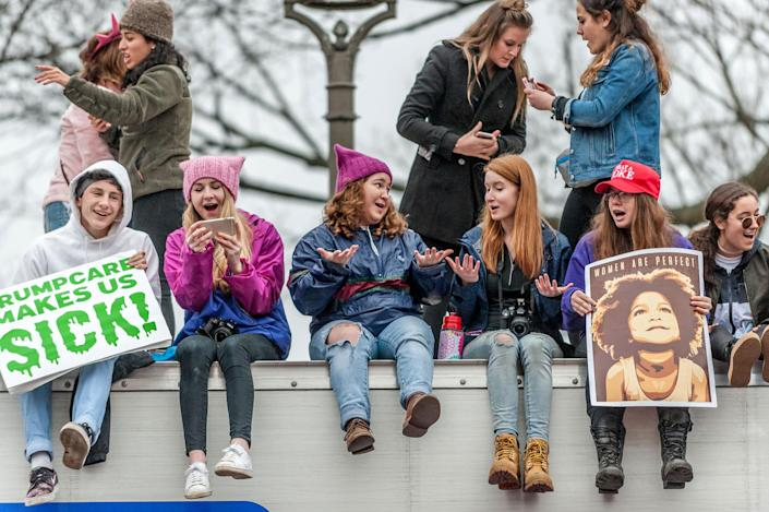 "<p>Marchers sat on top of a truck and chanted: ""Hands too small can't build a wall!"" Thousands of demonstrators gather in the Nation's Capital for the Women's March on Washington to protest the policies of President Donald Trump. January 21, 2017. (Photo: Mary F. Calvert for Yahoo News) </p>"