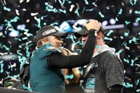 Feb 4, 2018; Minneapolis, MN, USA; Philadelphia Eagles quarterback Nick Foles (9) celebrates with Philadelphia Eagles quarterback Carson Wentz (R) after defeating the New England Patriots to win Super Bowl LII at U.S. Bank Stadium. Mandatory Credit: Kirt Dozier-USA TODAY Sports