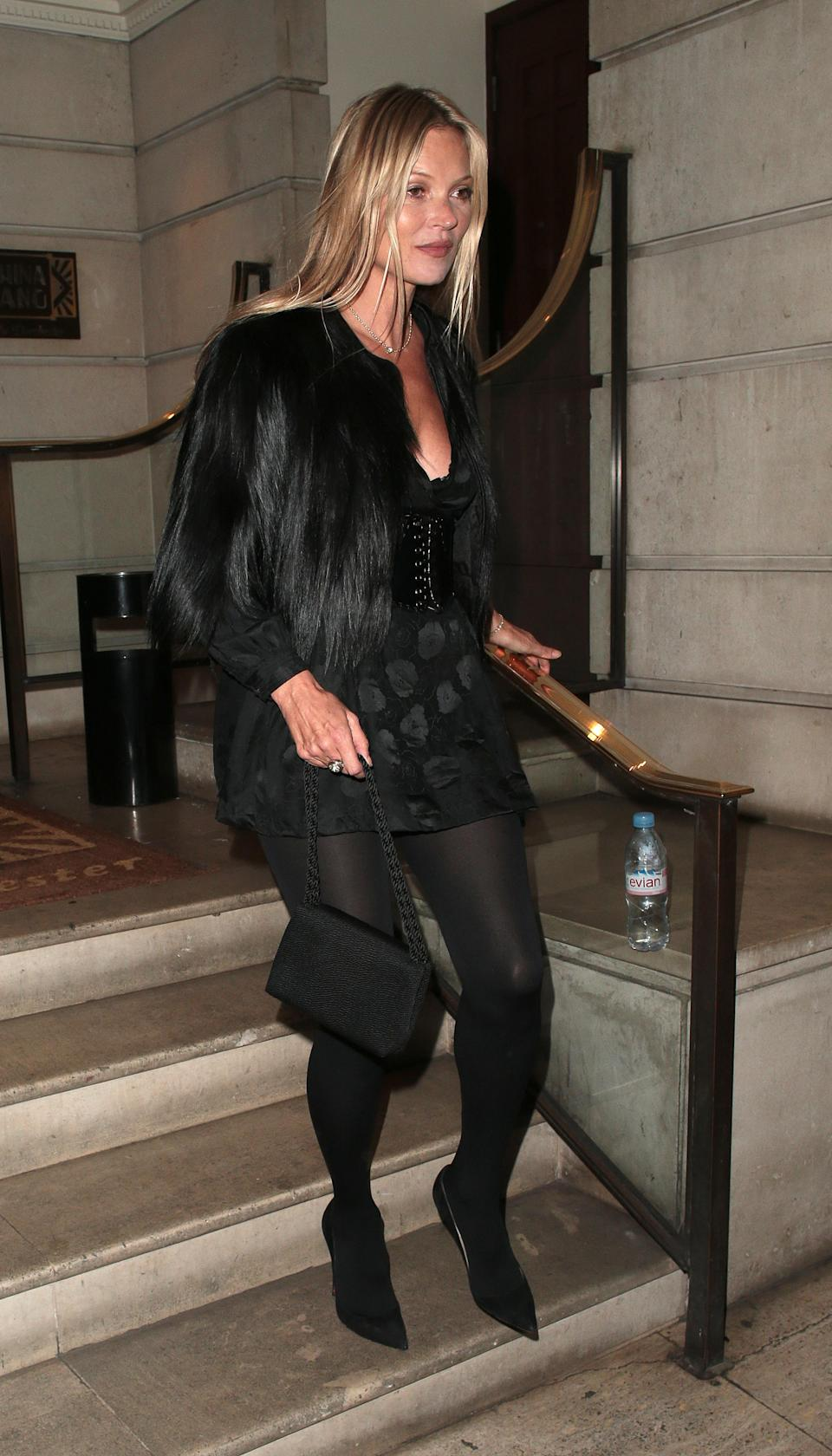 <p>For her 45th birthday celebrations, Kate Moss proved her style is only getting better in a seriously chic all-black ensemble finished with a Stella McCartney jacket. <em>[Photo: Getty]</em> </p>