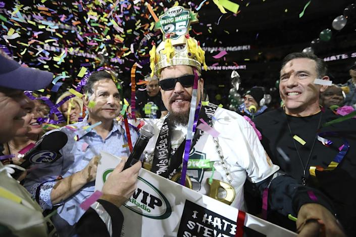 "Bob ""Notorious B.O.B."" Shoudt celebrates after winning the Wing Bowl on Friday, Feb. 3, 2017 in Philadelphia. The morning eating ordeal draws boozy spectators who tailgate beforehand outside the city's sports arena to watch flamboyant contestants and suggestively-clad women known as Wingettes. This year, rapper Coolio performed between rounds. (David Swanson/The Philadelphia Inquirer via AP)"