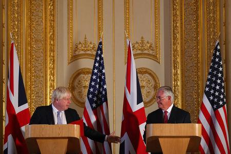 U.S. Secretary of State Rex Tillerson and Britain's State Secretary for Foreign and Commonwealth Affairs Boris Johnson speak during a news conference at Lancaster house in London