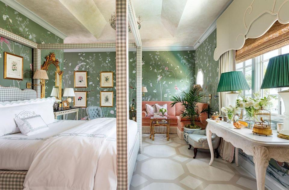 "<p>Although the predominant color of Bromley's bedroom may be green, ""Pink was our jumping-off point,"" says the designer. That's because the aptly-named ""Jardin des Perroquets"" was designed around the pink parakeets in de Gournay's wallpaper. ""From there, I knew that I wanted to layer in really soft tones, so that it would feel relaxed and not stuffy,"" says Bromley. Painted floors and a Venetian plaster ceiling add texture, while custom window treatments echo the curved legs of an antique console—and the custom headboard, which is covered in a laid-back gingham. ""We just wanted to create a place where you could hang out and relax,"" says Bromley. </p>"
