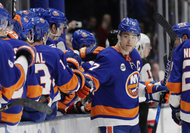 New York Islanders' Anders Lee (27) celebrates with teammates after scoring an empty net goal during the third period of an NHL hockey game against the New Jersey Devils, Thursday, Jan. 17, 2019, in Uniondale, N.Y. The Islanders won 4-1. (AP Photo/Frank Franklin II)