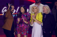 """Jimi Westbrook, from left, Karen Fairchild, Kimberly Schlapman, and Philip Sweet of Little Big Town accept the award for group/duo video of the year for """"Wine, Beer, Whiskey"""" at the CMT Music Awards at the Bridgestone Arena on Wednesday, June 9, 2021, in Nashville, Tenn. (AP Photo/Mark Humphrey)"""