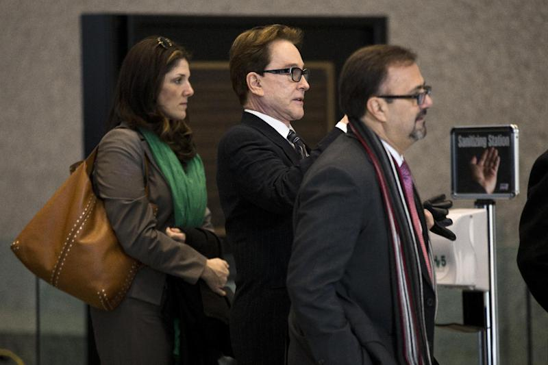 H. Ty Warner, center, the billionaire who created Beanie Babies, arrives at federal court for sentencing on Tuesday, Jan. 14, 2014, in Chicago. Last year Warner pleaded guilty to one count of tax evasion for hiding $25 million in income in secret Swiss bank accounts. (AP Photo/Andrew A. Nelles)