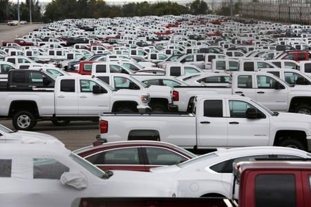 New trucks crowd a parking lot at the GM assembly plant in Oshawa
