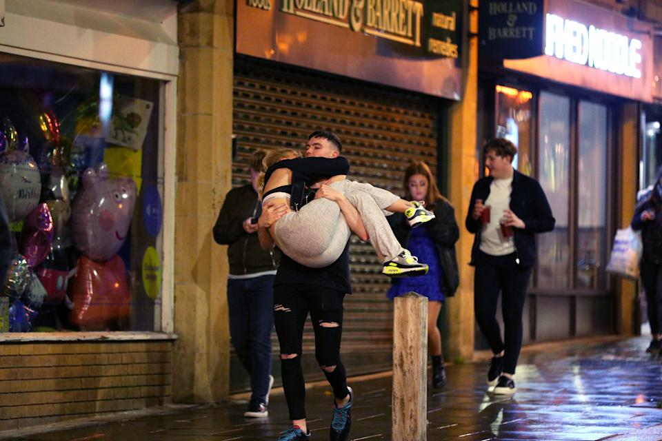 People out socialising in Liverpool city centre, ahead of the 10pm curfew that pubs and restaurants are subject to in order to combat the rise in coronavirus cases in England. Cities in northern England and other areas suffering a surge in Covid-19 cases may have pubs and restaurants temporarily closed to combat the spread of the virus.