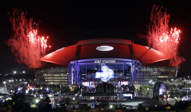 Pyrotechnics are fired off the top of AT&T Stadium at the end of the third round of the NFL football draft Friday, April 27, 2018, in Arlington, Texas. (AP Photo/Eric Gay)