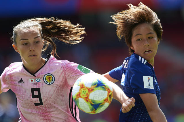Japan's Mana Iwabuchi, right, vies for the ball against Scotland's Caroline Weir on Friday in Rennes, France. (Getty)
