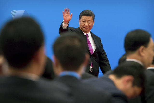 FILE - In this Saturday, April 27, 2019, file photo, Chinese President Xi Jinping waves as he leaves after a news conference on the outskirts of Beijing. Fuming over Washington's latest tariff hike in an escalating trade battle, Beijing has an array of options for retaliating, from limiting exports of rare earths to disrupting operations of Apple and other American companies in China. But they carry economic and political costs. And there is no guarantee they will work. (AP Photo/Mark Schiefelbein, File)