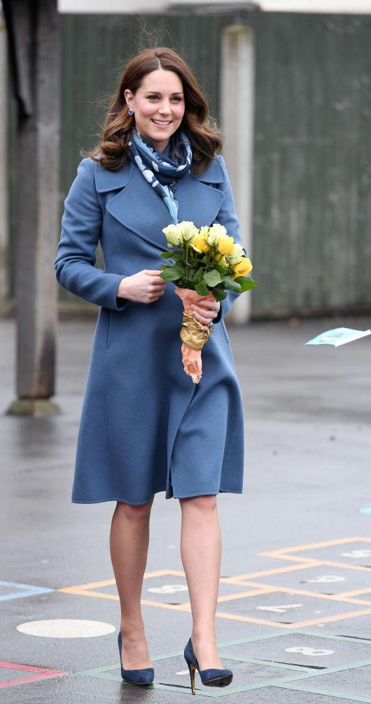 "<p>On January 23rd, the Duchess of Cambridge recycled a powder blue coat by Sportmax for a visit to Roe Green Primary School.<br>Kate Middleton first donned the look back in 2015 when expecting Princess Charlotte. She accessorised the look with Rupert Sanderson court shoes and a £95 printed scarf by <a rel=""nofollow noopener"" href=""https://www.beulahlondon.com/product/elena-scarf-navy-henri-print/"" target=""_blank"" data-ylk=""slk:Beulah London"" class=""link rapid-noclick-resp"">Beulah London</a>. <em>[Photo: Getty]</em> </p>"