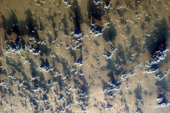 Canadian Space Agency astronaut Chris Hadfield posted this dazzling view of clouds and shadows off the China coast on Feb. 9, 2013, to mark Chinese New Year,